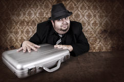 Businessman and his suitcase Stock Photo