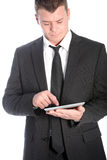 Businessman with his tablet Stock Photo