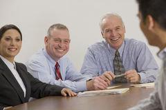 Businessman and his team. Royalty Free Stock Photo