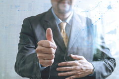 Businessman with his thumb up Front view, no head. Concept of wo. Rking in an office.business strategy icons interface Royalty Free Stock Photo
