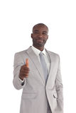 Businessman with his thumbs up Royalty Free Stock Images