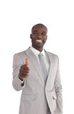 Businessman with his thumbs up Stock Photo