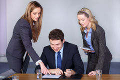Businessman and his two female advisors Royalty Free Stock Images