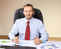 Businessman at his workplace Stock Photo
