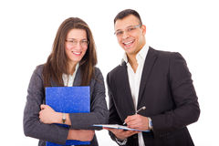 Businessman and his young secretary with notes Stock Photography