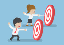 Businessman hit the center of target by sword. Businessman and Women Hit The Center of Target by Sword, Business Target Concept Stock Photography