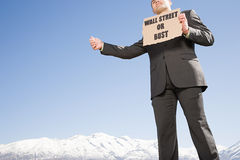 Businessman hitching a ride Stock Photo