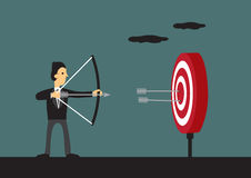 Businessman Hits Bullseye on Target Vector Cartoon Illustration. Cartoon man holding bow and arrow aiming at center of target with two arrows on bulls eye Royalty Free Stock Image