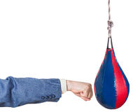 Businessman hits punching bag isolated Royalty Free Stock Photos