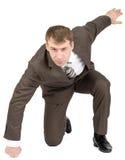 Businessman hitting floor Royalty Free Stock Image
