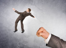 Businessman hitting little man Royalty Free Stock Photo