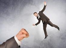 Businessman hitting little man Stock Images
