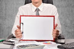 Businessman holaing blank clipboard Stock Images