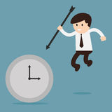 Businessman hold the arrow killing the time.  Stock Image