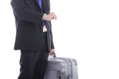 Businessman hold baggage and watch time Royalty Free Stock Photography