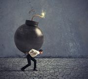 Businessman hold a bomb. Concept of difficult career and failure stock photo