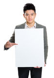 Businessman hold blank board to present something Royalty Free Stock Photography