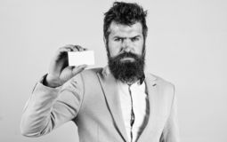Businessman hold blank card. Bearded hipster serious face show card. Banking services for business. Business card design. Card copy space professional royalty free stock photos