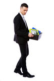 Businessman hold box with personal belongings Royalty Free Stock Photos
