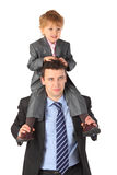 Businessman hold boy on neck Stock Image