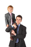 Businessman hold boy on shoulder Royalty Free Stock Photos
