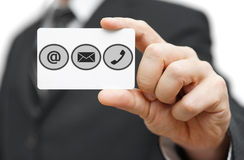 Businessman hold business card  with identification symbols.  Su Royalty Free Stock Image