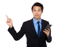 Businessman hold with cellphone and finger up Royalty Free Stock Images