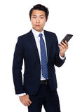 Businessman hold with cellphone Stock Photo