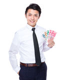 Businessman hold with Chinese banknote Stock Images