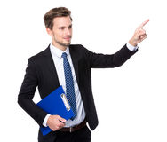 Businessman hold clipboard and finger point up Royalty Free Stock Photo