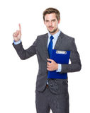 Businessman hold clipboard and finger point up Royalty Free Stock Photography