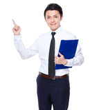 Businessman hold with clipboard and finger point up Stock Photography