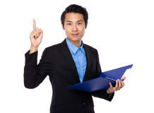 Businessman hold with clipboard and finger pointing up Stock Photo