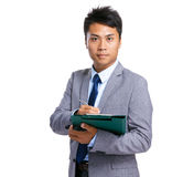 Businessman hold clipboard Stock Images