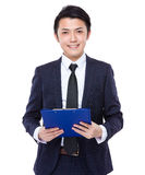 Businessman hold with clipboard Stock Image
