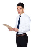 Businessman hold with clipboard Royalty Free Stock Image
