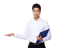 Businessman hold with clipboard and open hand palm Royalty Free Stock Images
