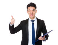 Businessman hold with clipboard and thumb up Royalty Free Stock Photos