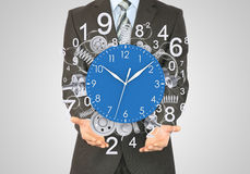 Businessman hold clock Stock Images