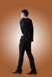 Businessman hold coat Royalty Free Stock Image