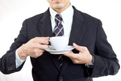 Businessman hold coffee cup for drink Royalty Free Stock Photography