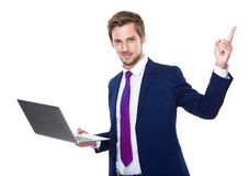 Businessman hold computer Royalty Free Stock Photography