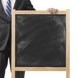Businessman hold dirty wooden chalk board. In white background Stock Photography
