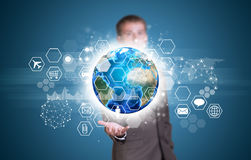 Businessman hold Earth with graphs, hexagons and Royalty Free Stock Photo