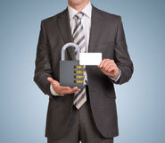 Businessman hold empty card and combination lock Royalty Free Stock Photos