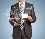 Businessman hold empty card and graphs, world map Royalty Free Stock Photos