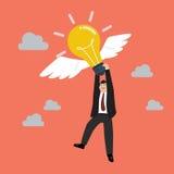 Businessman hold flying lightbulb Stock Image