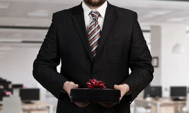 Businessman Hold Gift Box . Mixed Media Royalty Free Stock Photo