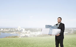 Businessman hold gift box Royalty Free Stock Image