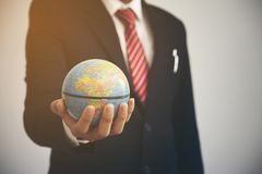 Businessman hold globe. Close up businessman hold globe royalty free stock photos